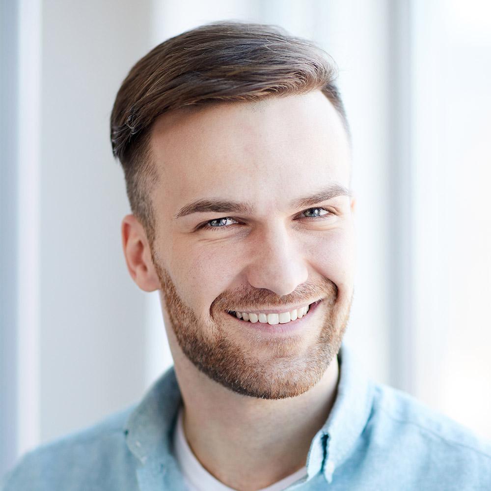 portrait-of-handsome-man-by-window-Q7G956M.jpg